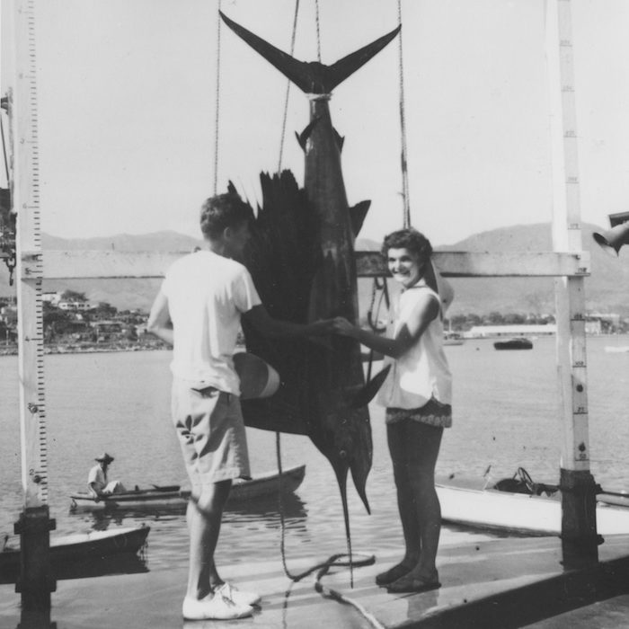 "PX81-32-49 September 1953 Senator John F. Kennedy and Jacqueline B. Kennedy pose with a sailfish caught on their honeymoon in Mexico. Please credit: ""Photographer unknown. John F. Kennedy Presidential Library and Museum, Boston"""